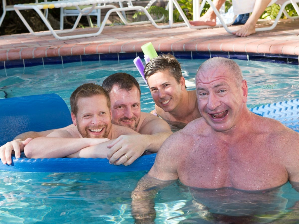 4 men in pool